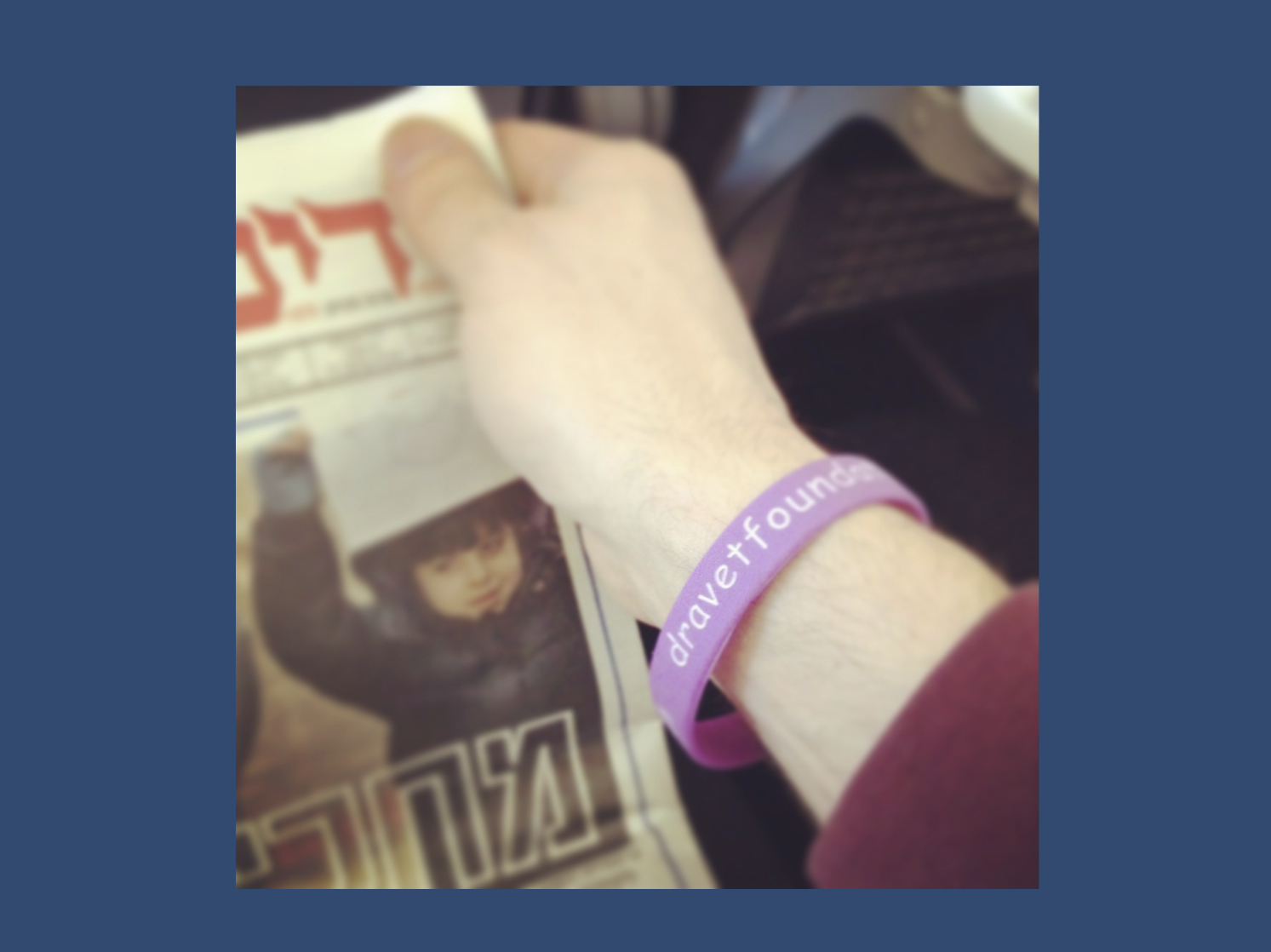 Wearing my Dravet Awareness bracelet on the flight to Tel Aviv last December.