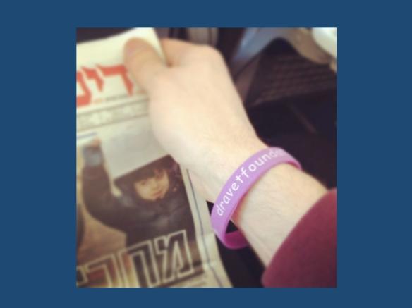 Wearing my Dravet Awareness bracelet on the flight to Tel Aviv last December.